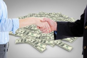 composite-image-of-close-up-of-a-business-people-closing-a-deal